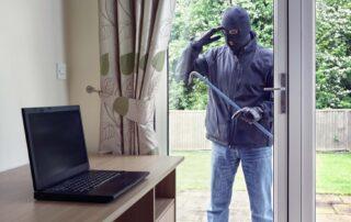 Burglar trying to steal laptop